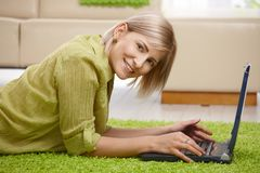 Smiling woman with computer at home Stock Photos