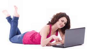 Smiling woman with computer PC Royalty Free Stock Images