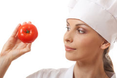 Smiling woman cook with red tomato Royalty Free Stock Photo