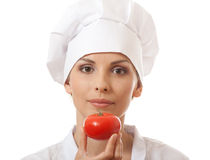 Smiling woman cook with red tomato Royalty Free Stock Photos