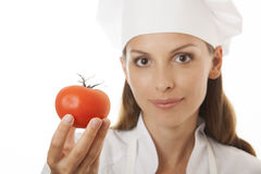 Smiling woman cook with red tomato Stock Photo