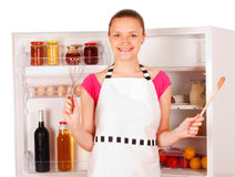 Smiling woman cooking Stock Photos