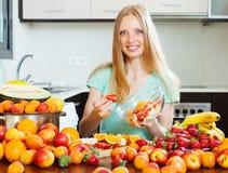 Smiling   woman cooking fruit salad Stock Photos