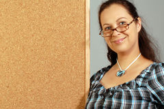 Smiling woman with cork board Stock Photos