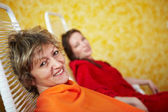 Smiling woman on couch Stock Photos
