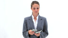 Smiling woman counting her dollar notes Stock Photo