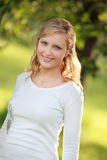 Smiling woman in countryside Royalty Free Stock Image