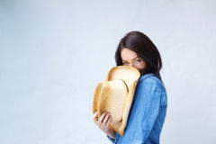 Smiling woman covering face with cowboy hat Stock Photography