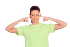 Smiling woman covering her ears Royalty Free Stock Photography