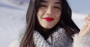 Smiling woman in cowl stock footage