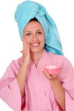 Smiling woman with a cream Stock Images