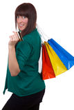 Smiling woman with credit card and shopping bags Royalty Free Stock Image