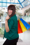 Smiling woman with credit card and shopping bags Stock Photo