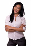 Smiling woman with crossed arms Royalty Free Stock Image