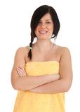 Smiling woman with crossed arms in yellow towel Royalty Free Stock Photos