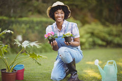 Smiling woman crouching in the garden Stock Image