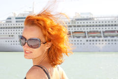Smiling woman and cruise ship on background Stock Photos