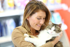Smiling woman cuddling cat in her arms Royalty Free Stock Photo