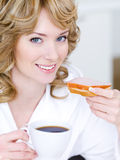 Smiling woman with cup of coffee stock photography