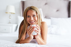 Smiling woman with cup of coffee or tea Stock Photography