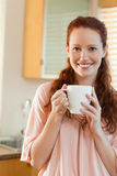 Smiling woman with cup in her hands Stock Image