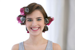 Smiling woman with curlers on her head Royalty Free Stock Photography