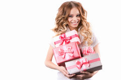 Smiling woman with curly hair holding gifts Isolated on white background. Royalty Free Stock Photography