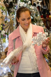 Smiling woman customer buying snowflake ornament Stock Image