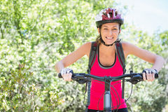 Smiling woman cycling Stock Photography