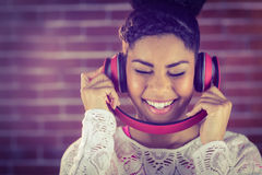 A smiling woman dancing with headphones Stock Photography