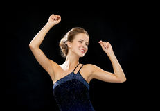 Smiling woman dancing with raised hands Royalty Free Stock Photo