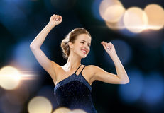 Smiling woman dancing with raised hands Royalty Free Stock Images
