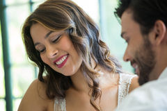 Smiling woman dating with man in restaurant Royalty Free Stock Photo
