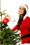 Smiling woman decorating christmas tree Stock Photos