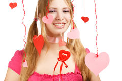 Smiling woman with designer red and pink paper valentine hearts Stock Photo
