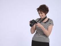 Smiling Woman With Digital Camera Royalty Free Stock Image