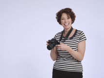 Smiling Woman With Digital Camera Stock Images