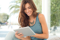 Smiling Woman With Digital Tablet Royalty Free Stock Image