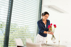 Smiling woman dinner room Royalty Free Stock Photos