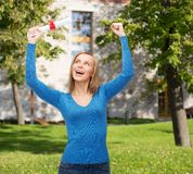 Smiling woman with diploma Royalty Free Stock Images