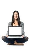 Smiling woman displaying her blank laptop screen Stock Photo