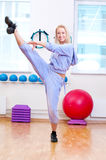 Smiling woman do stretching exercise Royalty Free Stock Image