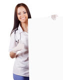 Smiling woman doctor with a banner. Isolated. Royalty Free Stock Photography