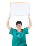 Smiling woman doctor keeping  blank poster Stock Photography