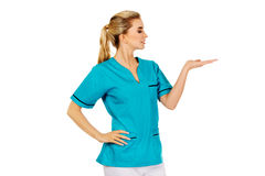Smiling woman doctor or nurse pointing something Royalty Free Stock Photos