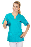 Smiling woman doctor or nurse with thumb up Stock Photo