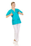 Smiling woman doctor or nurse with thumb up Royalty Free Stock Photography