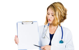 Smiling woman doctor showing empty blank clipboard sign Stock Images