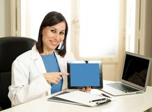 Smiling woman Doctor specialist having consultation using digital tablet to inform patient royalty free stock photos