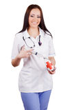Smiling woman doctor with a syringe and vaccine bank in hands. Royalty Free Stock Photos